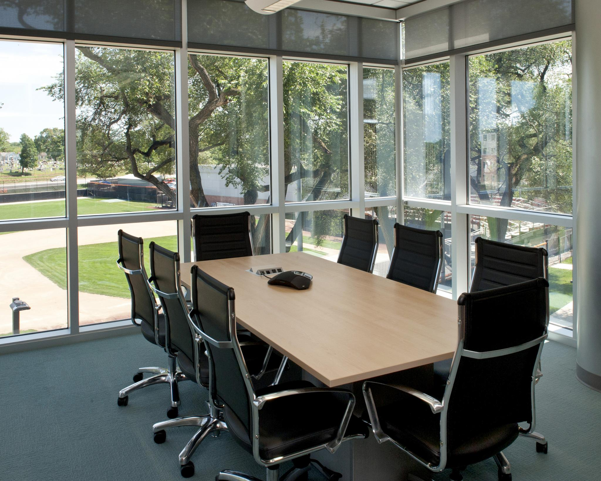 meeting room with windows and conference table