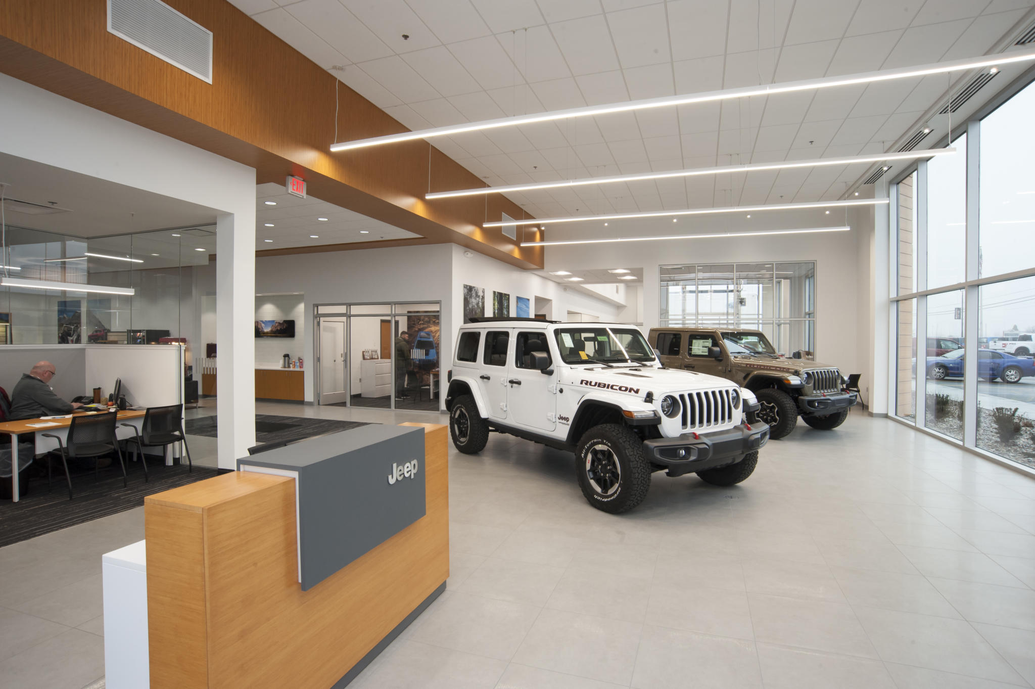 photo of a jeep inside the showrooom at car dealership