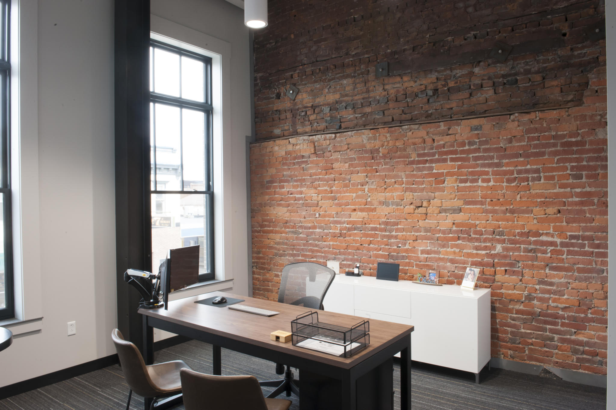 an image of an office with brick walls
