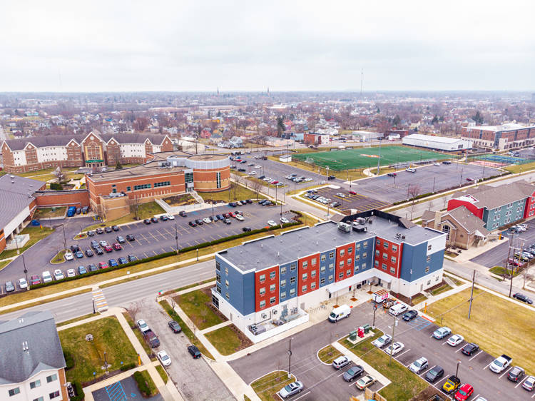 aerial image of apartment building and college campus