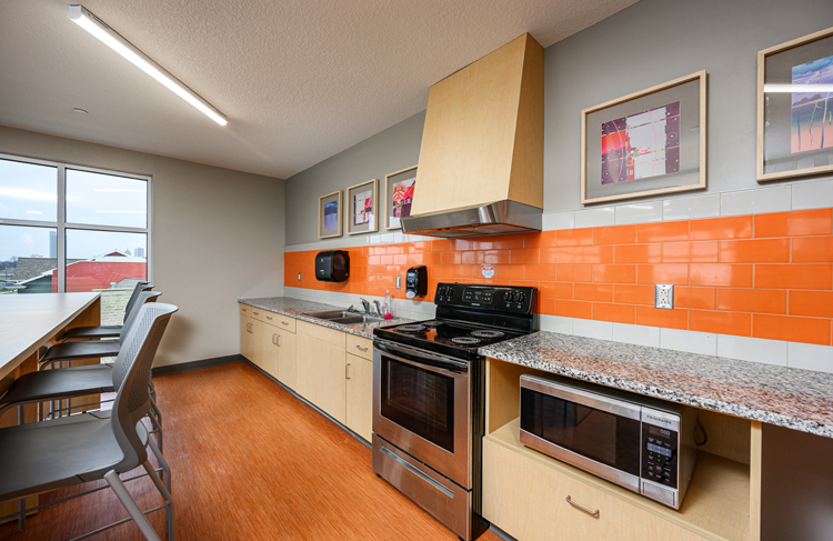 image of kitchen with range and sink