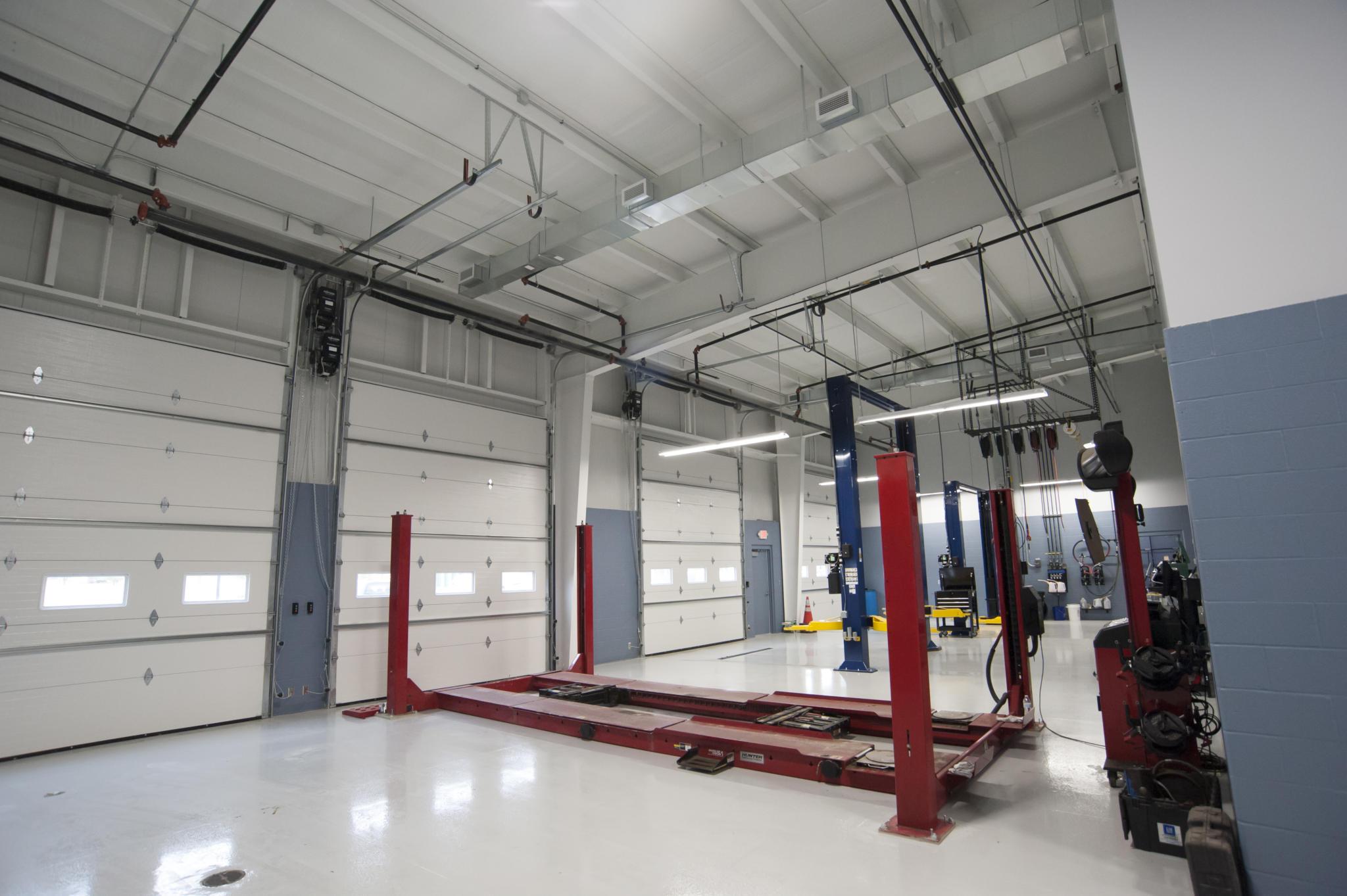 image of garage doors inside auto repair shop