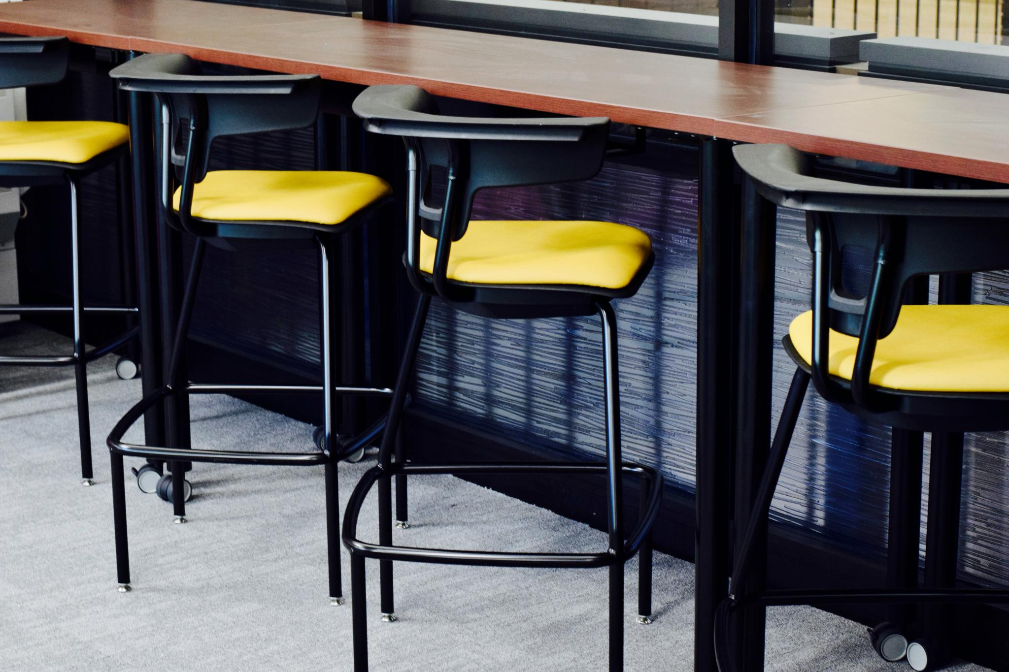 photo of stools in front of table