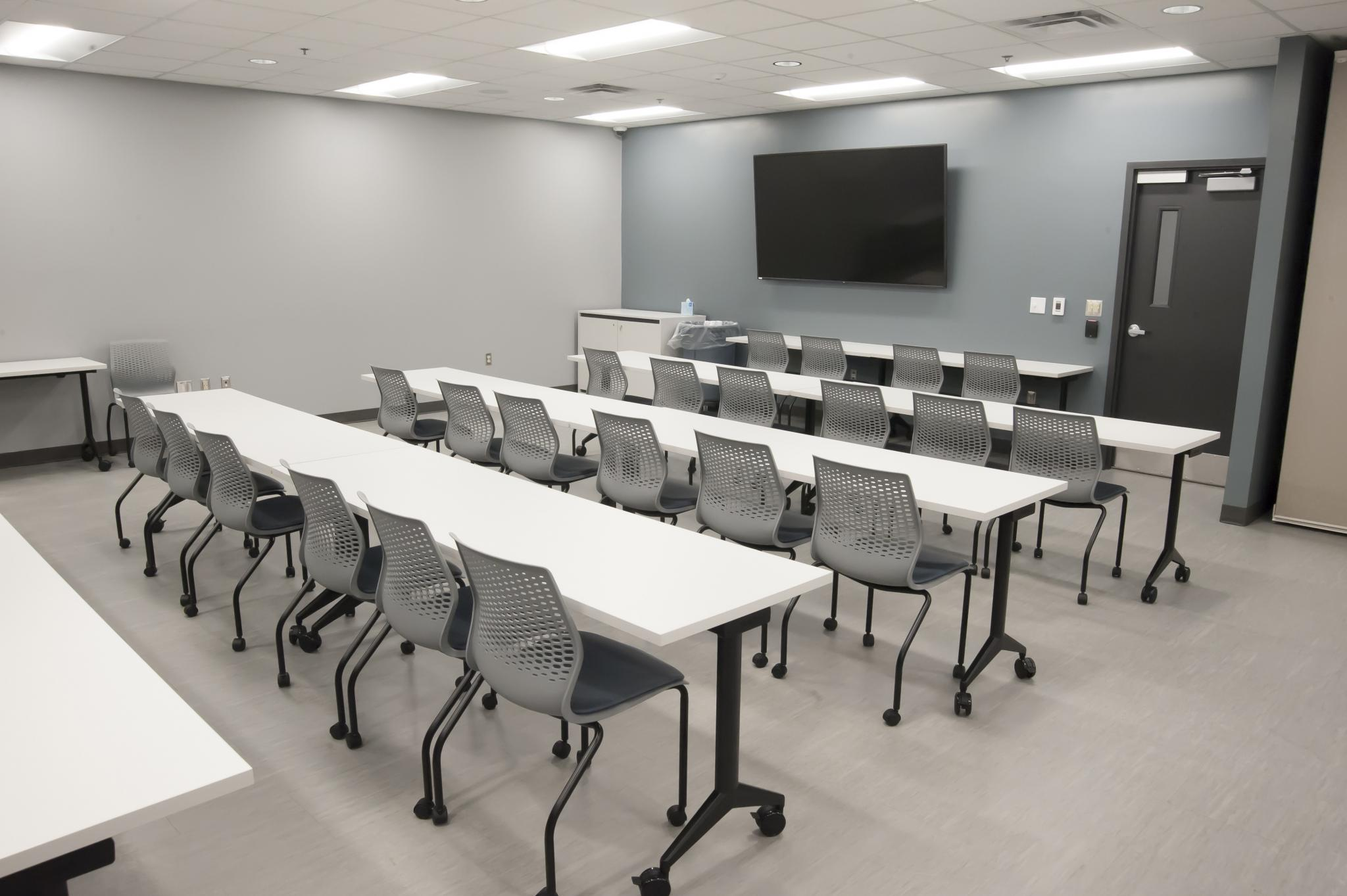 image of tables lined up in conference room