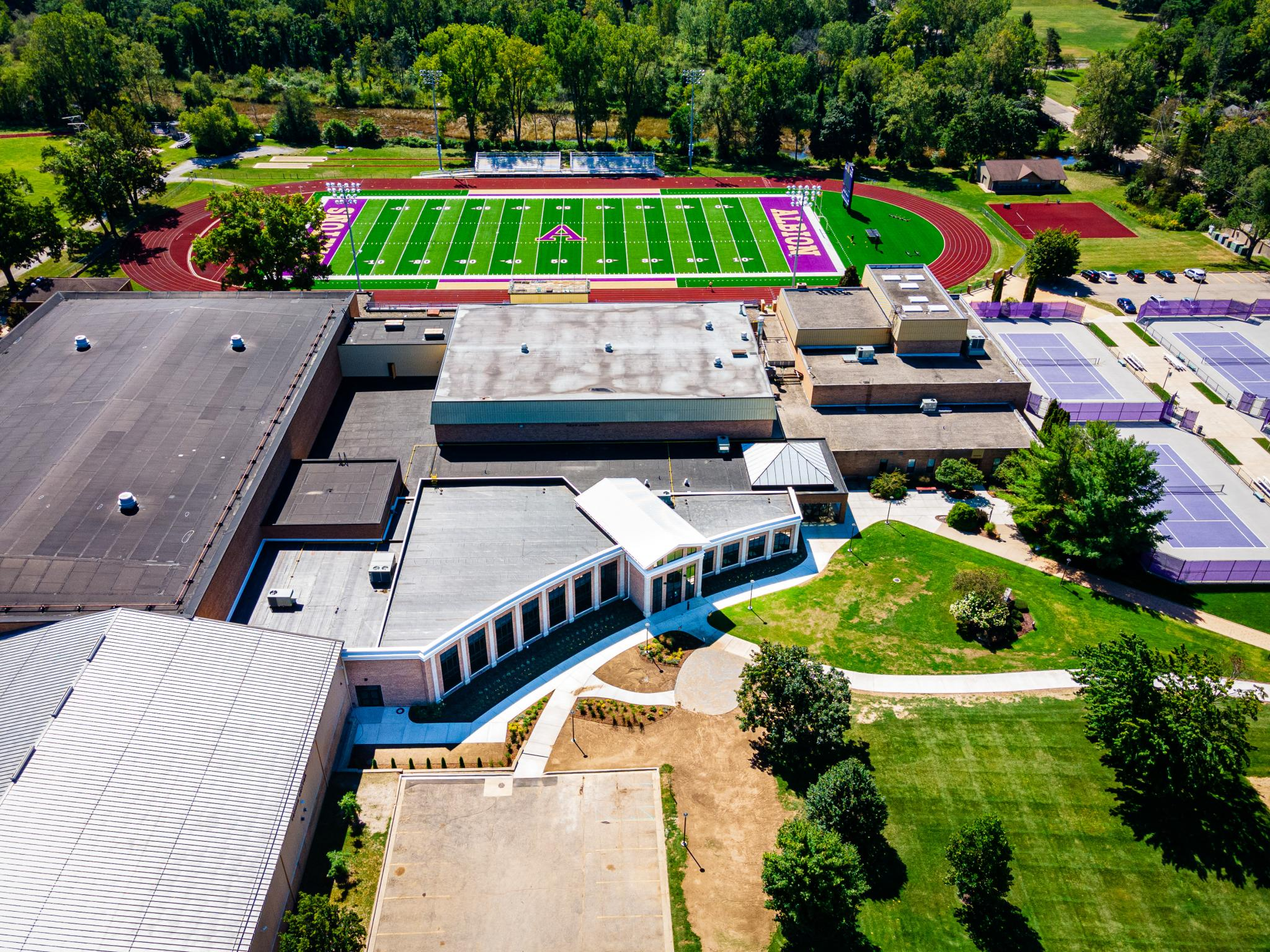 aerial image of building with athletics field nearby