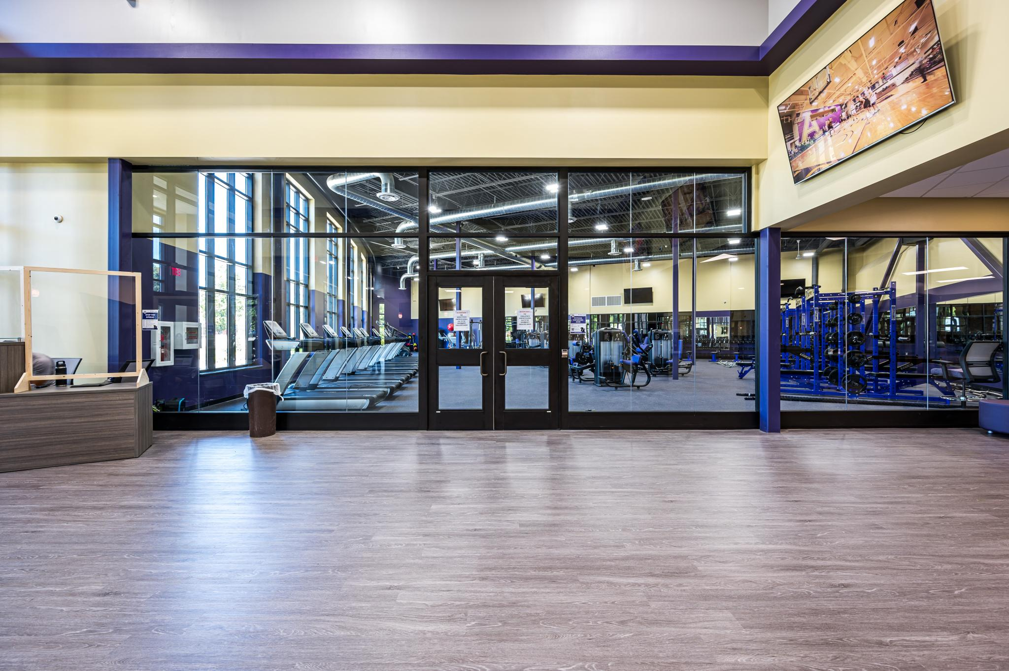 image of pair of glass doors into a room with fitness equipment