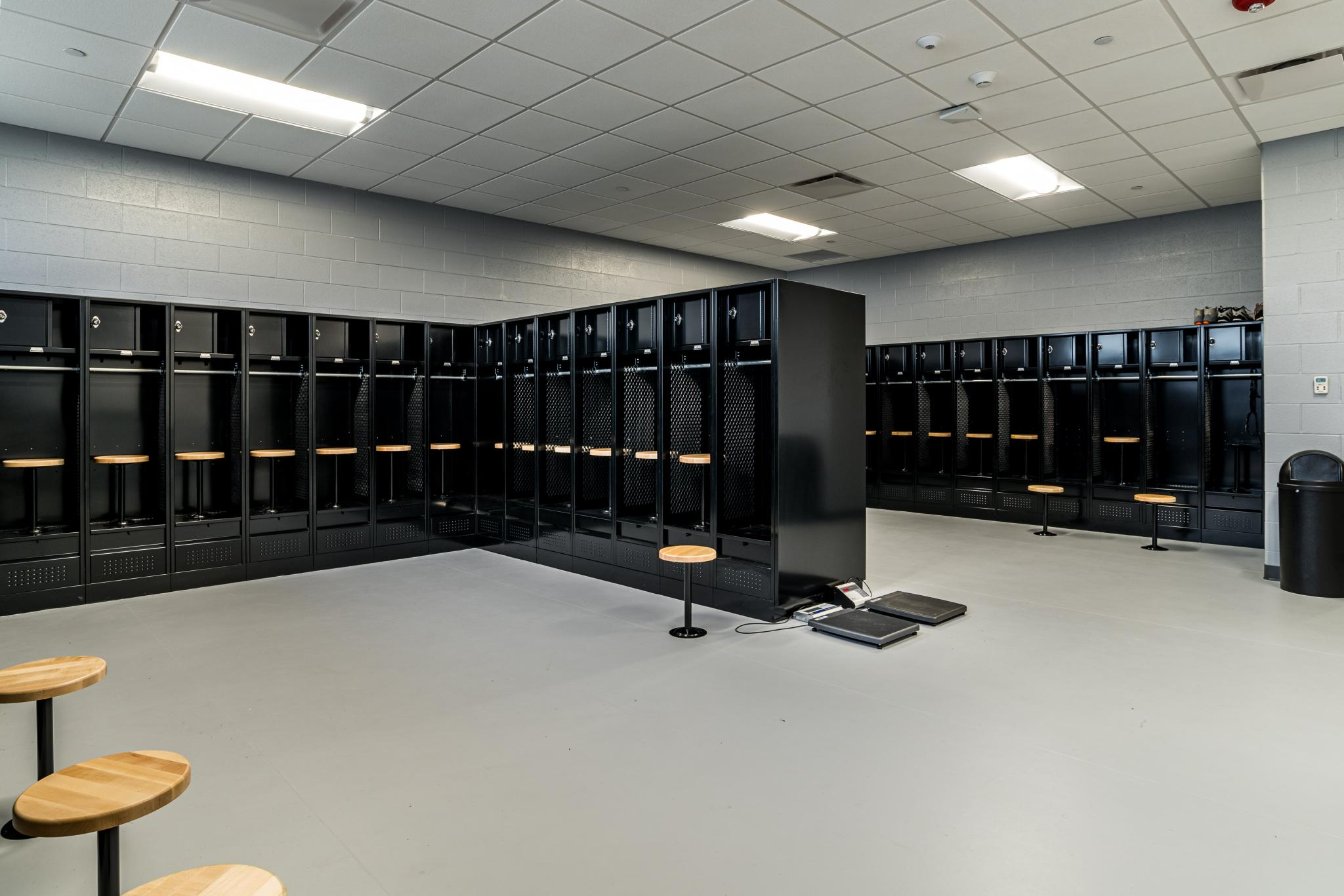 photo of a locker room with black painted lockers