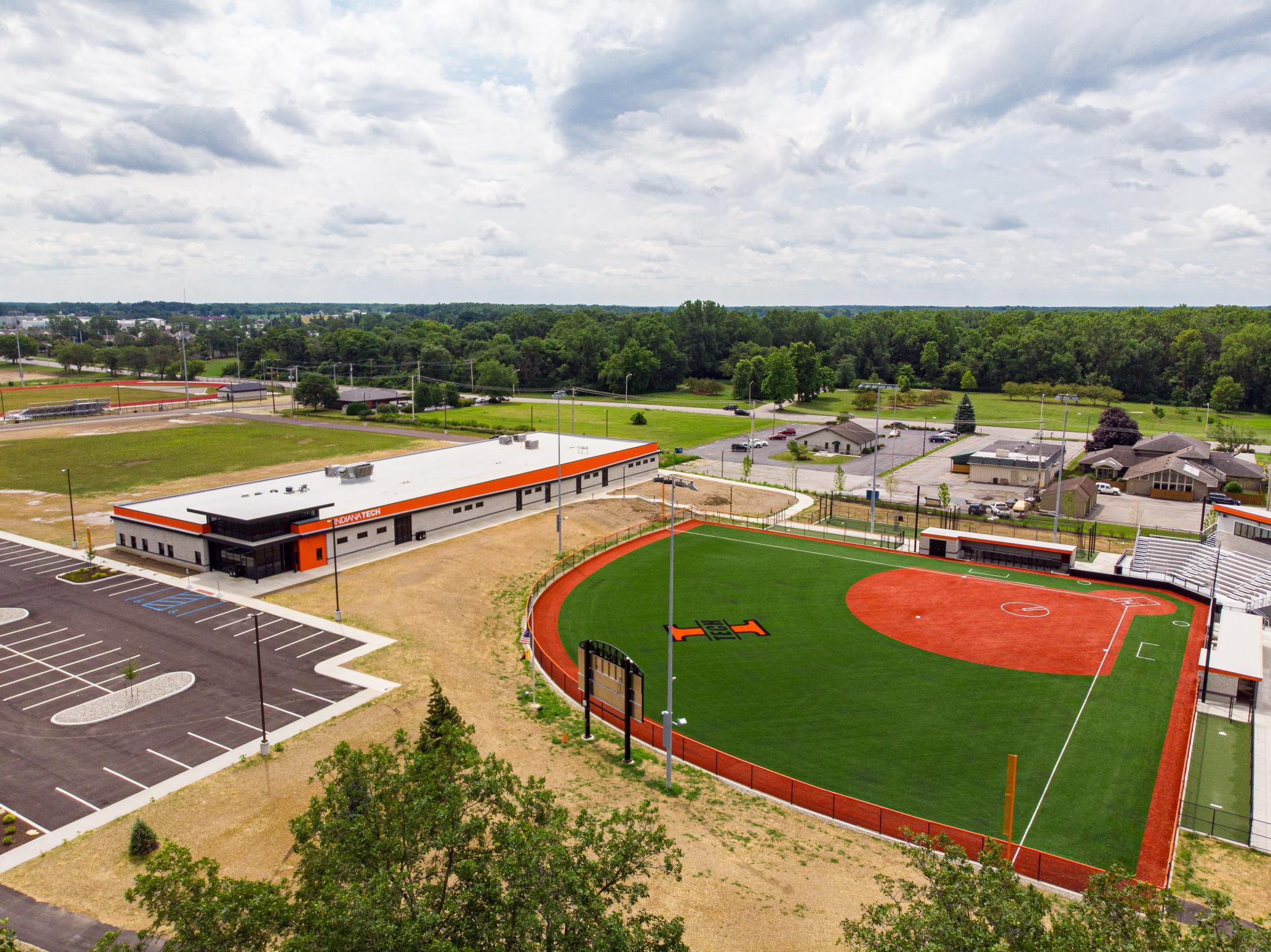 drone image of a softball field and building