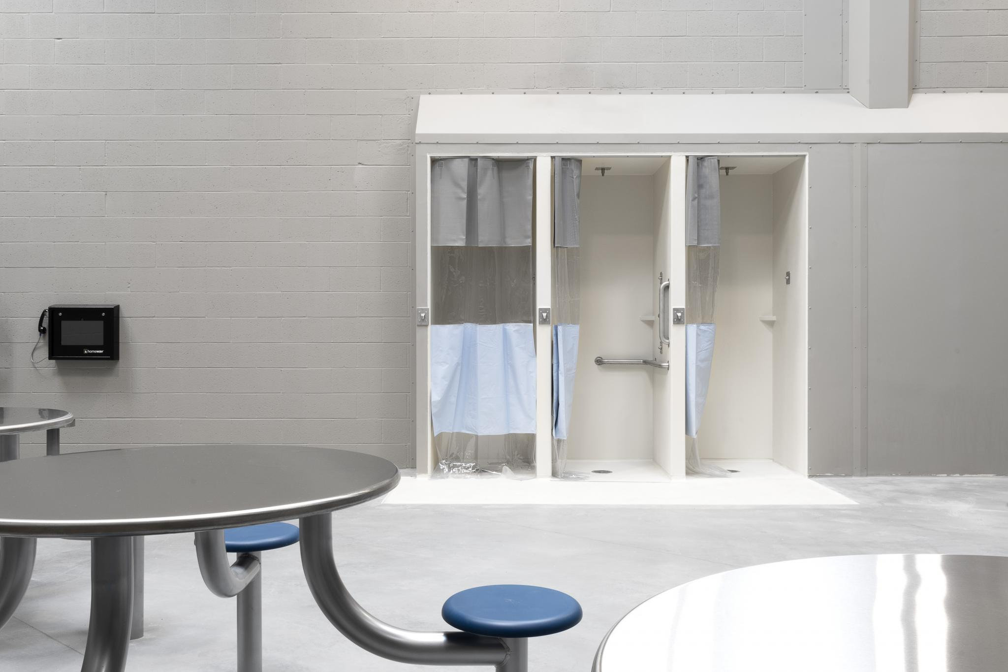 image of a table with chairs and shower stalls