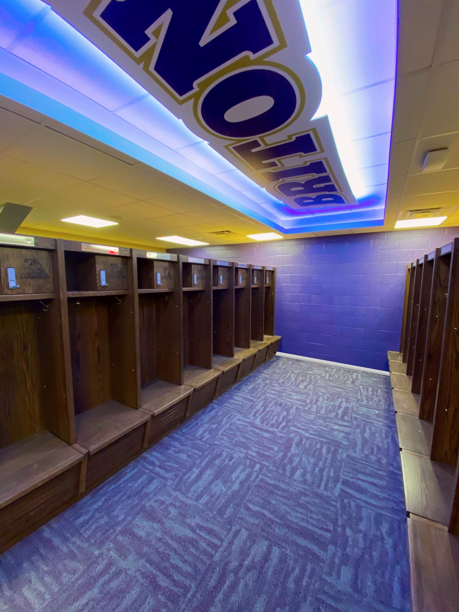 image of purple carpet and set of wooden lockers