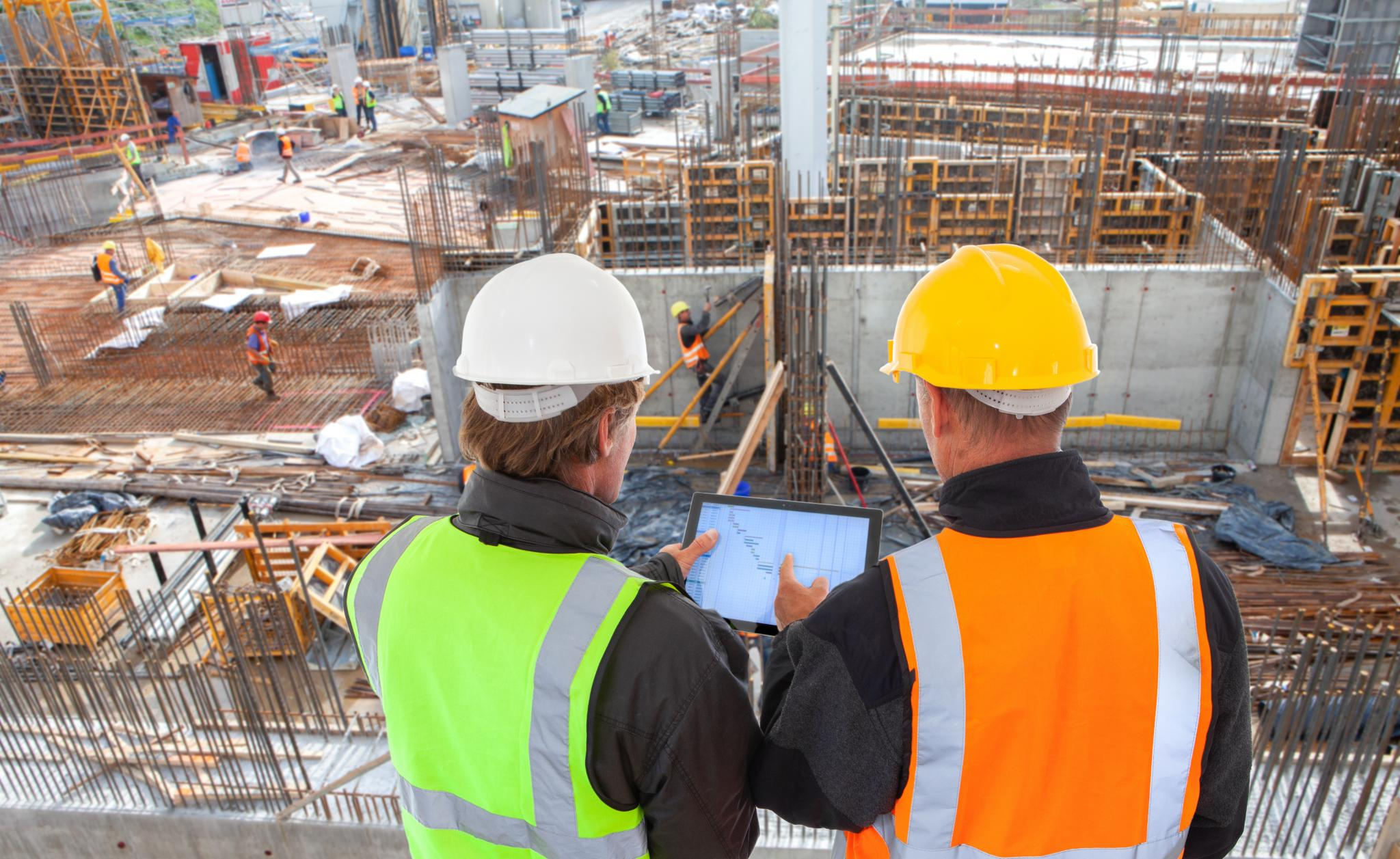 an image of construction and architecture personnel at an active construction site